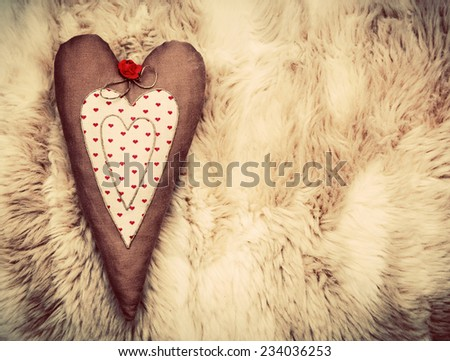 Vintage handmade plush heart pillow on the soft blanket, Valentine's Day, love concepts. - stock photo