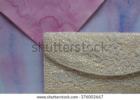 Vintage handmade white clutch purse with pearls and sequins   - stock photo