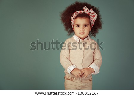 Vintage happy girl against green background. - stock photo