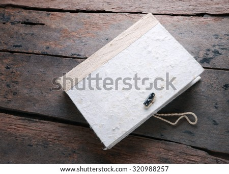 Vintage hardcover on old wooden table. - stock photo