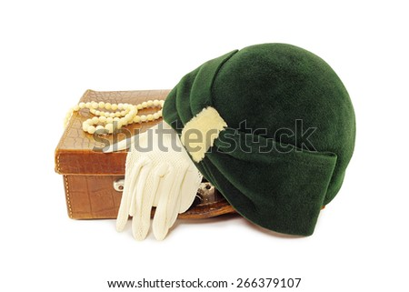 Vintage hat and gloves on leather bag isolated on white background - stock photo
