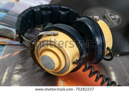 Vintage headphone and old vinyls - stock photo