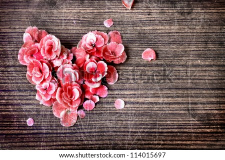 vintage heart from flowers   on wooden table/valentin day background - stock photo