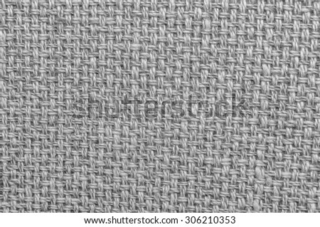 Vintage heavy woven canvas cloth fragment in tones of black, white, and gray/grey. - stock photo