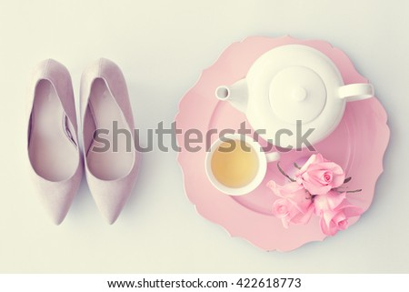 Vintage heels, tea cup, teapot and roses flat lay - stock photo