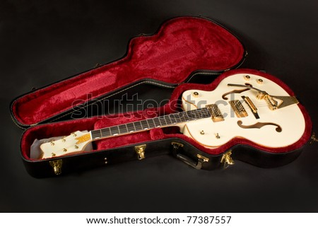 Vintage hollow body guitar in case - stock photo