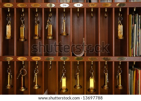 Hotel front desk stock photos images pictures shutterstock - Vintage hotel key rack ...