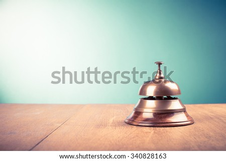 Vintage hotel reception service desk bell. Old retro style filtered photo - stock photo