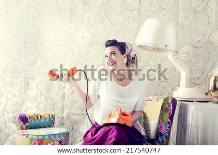 vintage housewife chats on the phone in Hair salon - stock photo