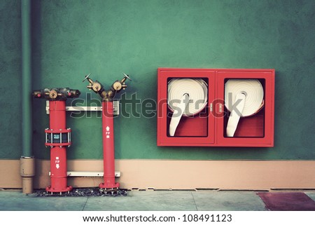 Vintage Hydrant with water hoses and fire extinguish equipment - stock photo