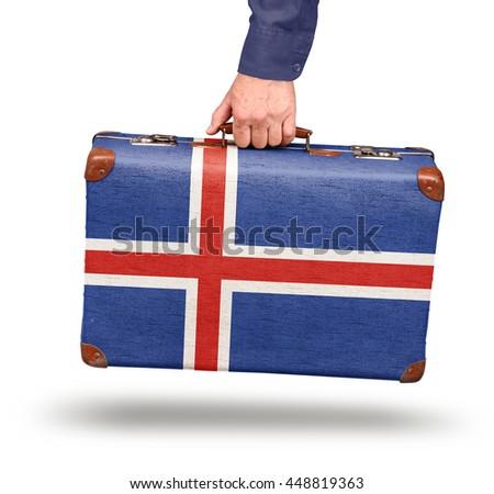 Vintage Icelandic flag suitcase isolated on white travel to Iceland concept - stock photo
