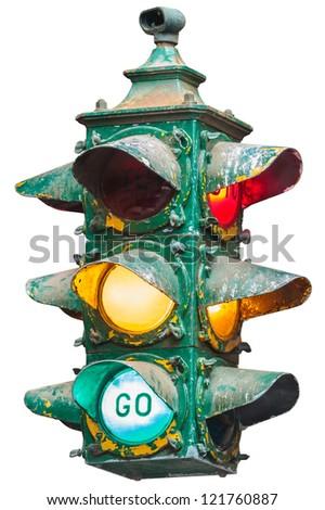 Vintage illuminated American traffic light isolated on white - stock photo