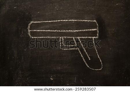 vintage illustration with gun on blackboard background - stock photo