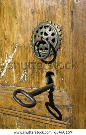 Vintage image of ancient door knocker on a wooden door in Epirus, north Greece - stock photo