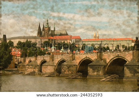 Vintage image of Charles Bridge with Prague castle in background - stock photo