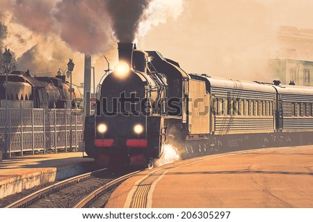 Vintage image of the departure of the retro steam train. - stock photo