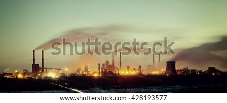 Vintage industrial landscape with chemical factory, pipes and smoke, long exposure - stock photo