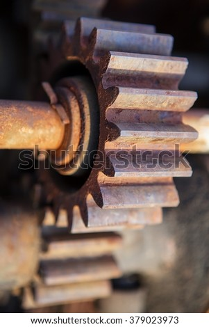 Vintage industrial rusted gears wheel in sepia - stock photo