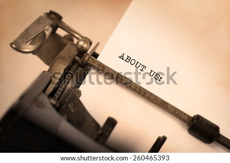 Vintage inscription made by old typewriter, About us - stock photo