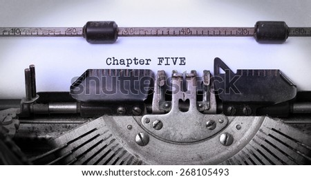 Vintage inscription made by old typewriter, chapter five - stock photo