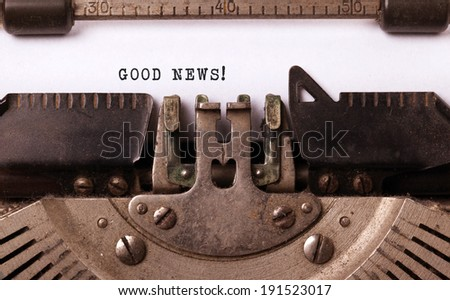Vintage inscription made by old typewriter, good news! - stock photo
