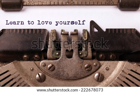 Vintage inscription made by old typewriter, Learn to love yourself - stock photo