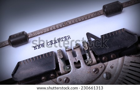 Vintage inscription made by old typewriter, New chapter - stock photo
