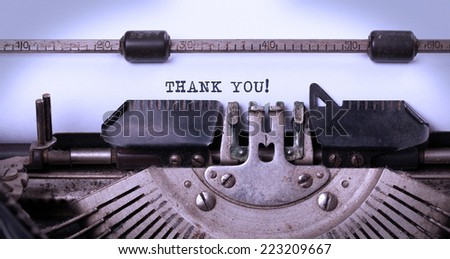 Vintage inscription made by old typewriter, thank you - stock photo