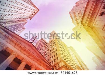 Vintage instagram filtered Wall Street at sunset, Manhattan, New York City, USA. - stock photo