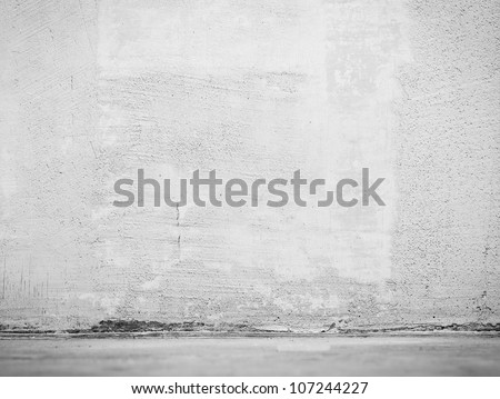 Vintage interior of stone wall and gray cement floor - stock photo