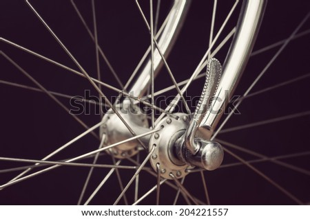 vintage italian bicycle front hub on black background - stock photo