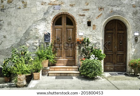 Vintage italian houses with flowers. Sun light - stock photo