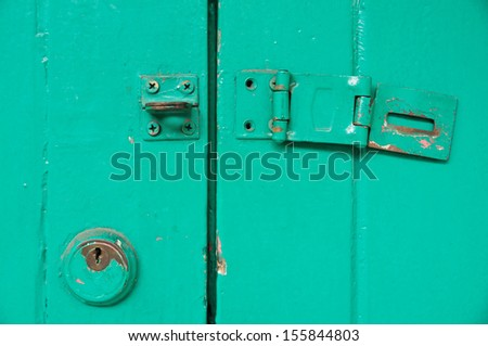 Vintage key hold and unlocked door - stock photo