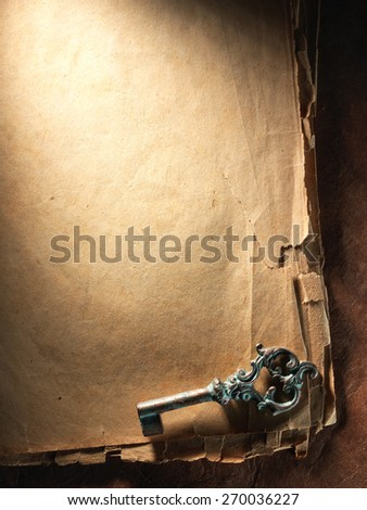 Vintage key on the very old paper - stock photo