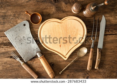 Vintage kitchen utensils on wooden table - stock photo