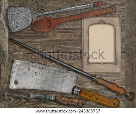 vintage kitchen utensils over wooden board, blank card for your text - stock photo