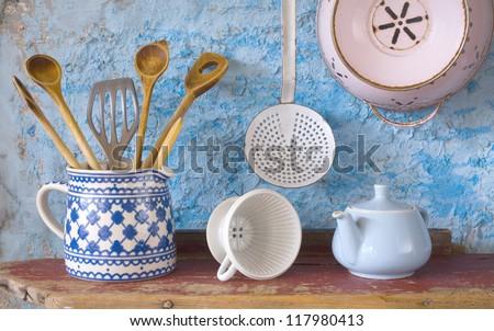 Vintage kitchen utensils, spatulas, coffee can,skimmer, china bone coffee filter - stock photo
