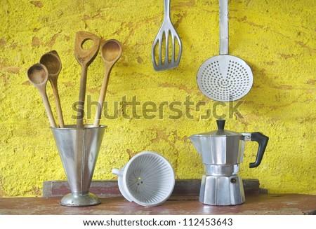 Vintage kitchen utensils, spatulas,espresso maker,skimmer,coffee filter, beaker - stock photo