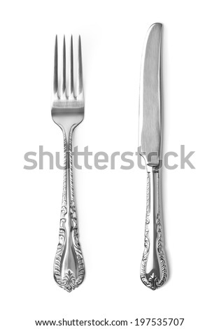 Vintage knife and fork on white background - stock photo