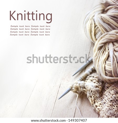 Vintage Knitting needles and yarn on wooden background/natural wool knitting background - stock photo
