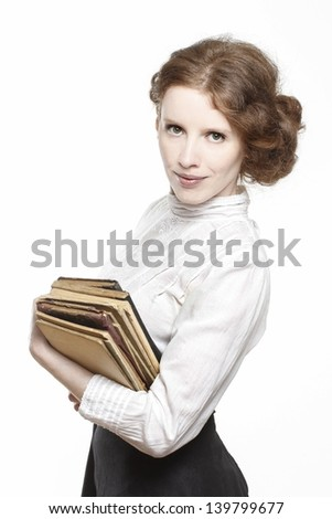 Vintage lady holding ancient books in beautiful hands - stock photo