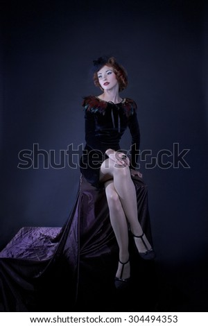 Vintage lady. Portrait of charming woman in retro image. - stock photo