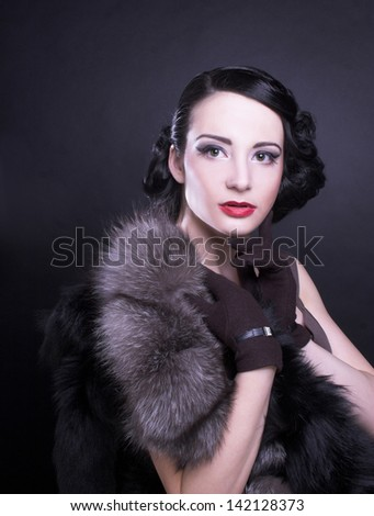Vintage lady. Young woman in brown dress and in furs. - stock photo
