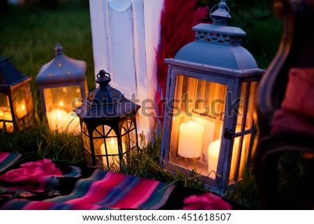 vintage lanterns with burning candle - stock photo