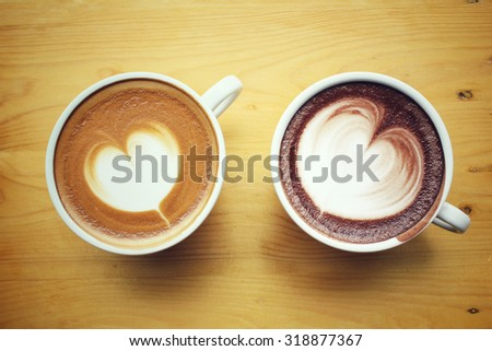 Vintage latte art coffee with hot chocolate - stock photo