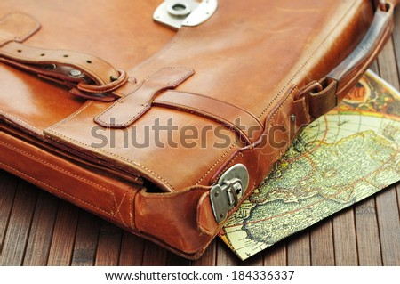 Vintage leather briefcase with old map  - stock photo