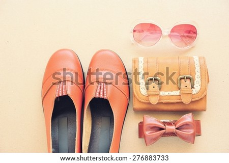 Vintage leather shoes ,leather wallet,fashion eye wear and belt on wooden floor. - stock photo