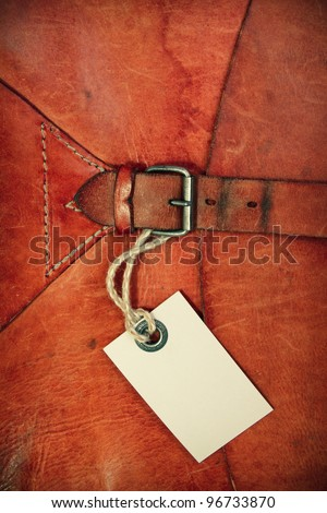 Vintage leather textured background with gift tag - stock photo
