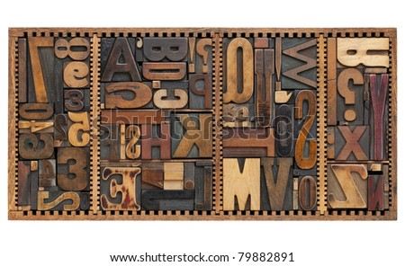vintage letterpress printing blocks abstract with variety of  letters, numbers, punctuation signs in old box - stock photo