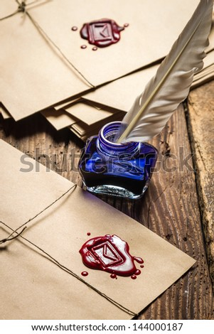 Vintage letters with red sealant - stock photo